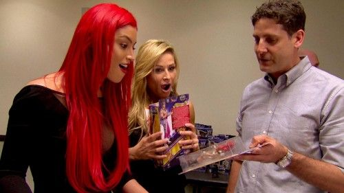 WWE Diva Eva Marie sees her first ever Mattel WWE figure as Natalya looks on!